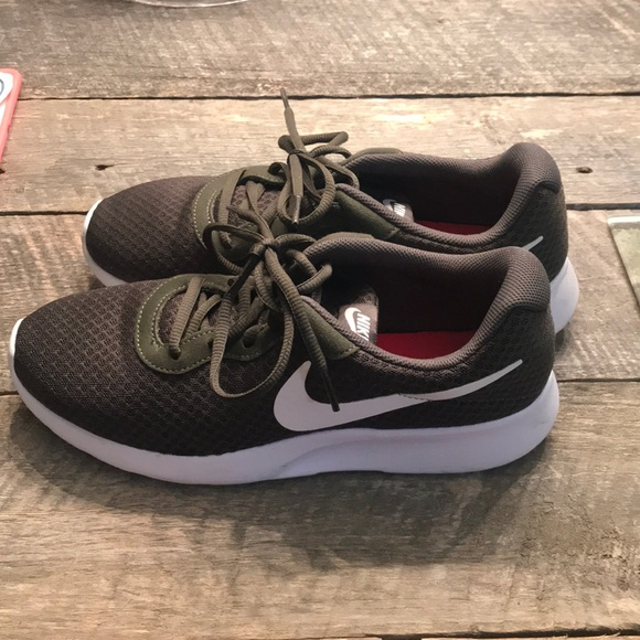 store preview of differently Olive Green Nike tennis shoes Men's 8.5=Women's 10